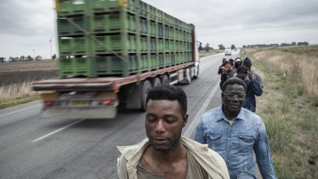 The Cameroonian-Italian farm worker activist and Jesus actor Yvan Sagnet with refugees and farm workers on the way to a tomato plantation